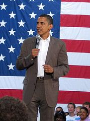Barak Obama Speaks Before an American Flag