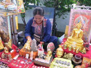 Women selling religious alms, Bangkok, Thailand